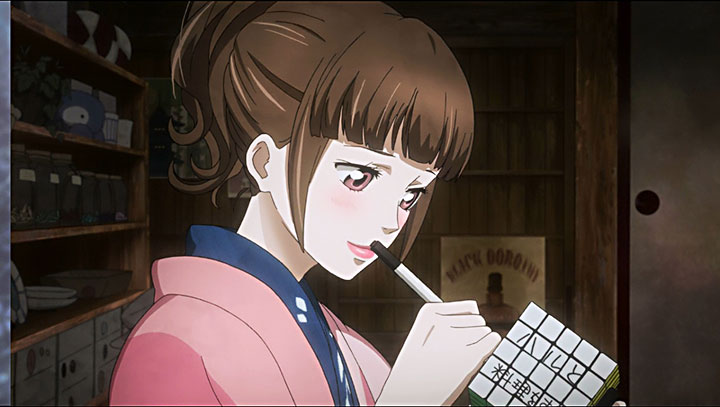 Kurumi escribiendo en uno de los cubos Rubik.
